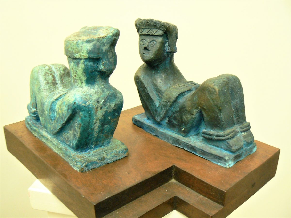Twin Cac Mool, cast bronze and mahogany