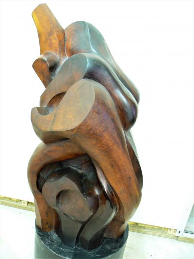 Family Portrait, carved mesquite on painted steel
