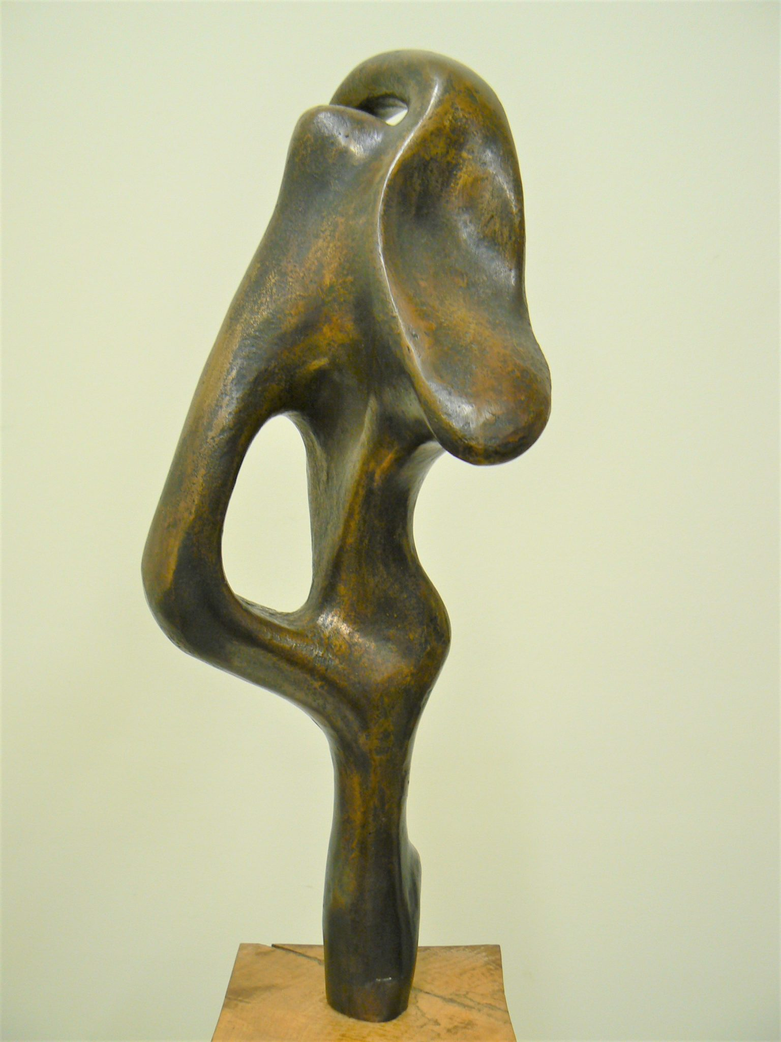 Two on One Point, cast bronze on pecan wood