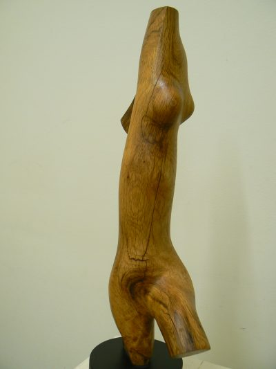 Lady Stepping Out, carved red oak. Sculpture for sale