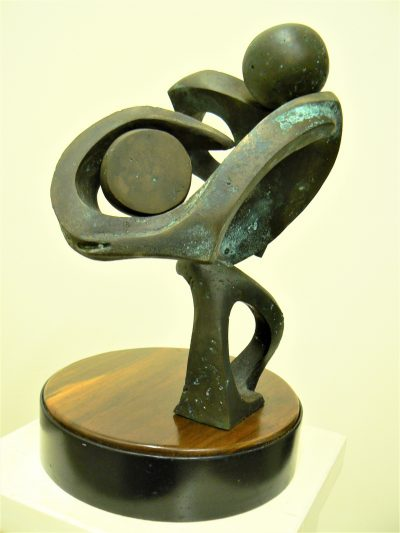 Discus Thrower, cast bronze on black walnut & painted steel