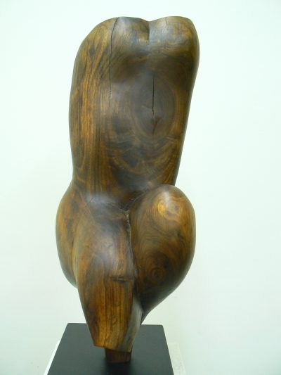 Balancing Boy Torso, carved walnut on painted steel