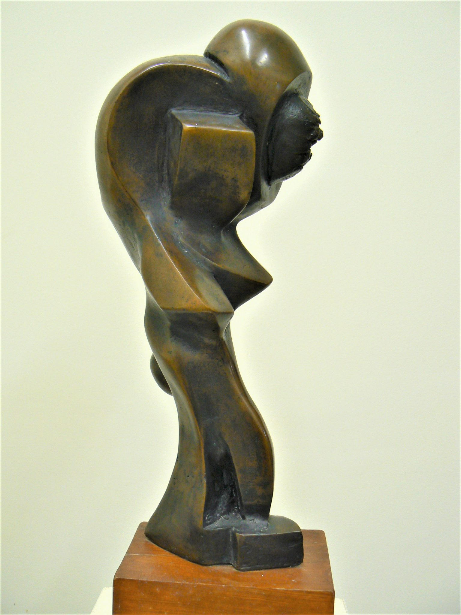 Polite, cast bronze on pecan, Abstract sculpture for sale