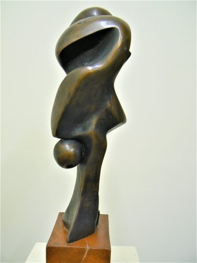 Polite, cast bronze sculpture on pecan Abstract sculpture for sale