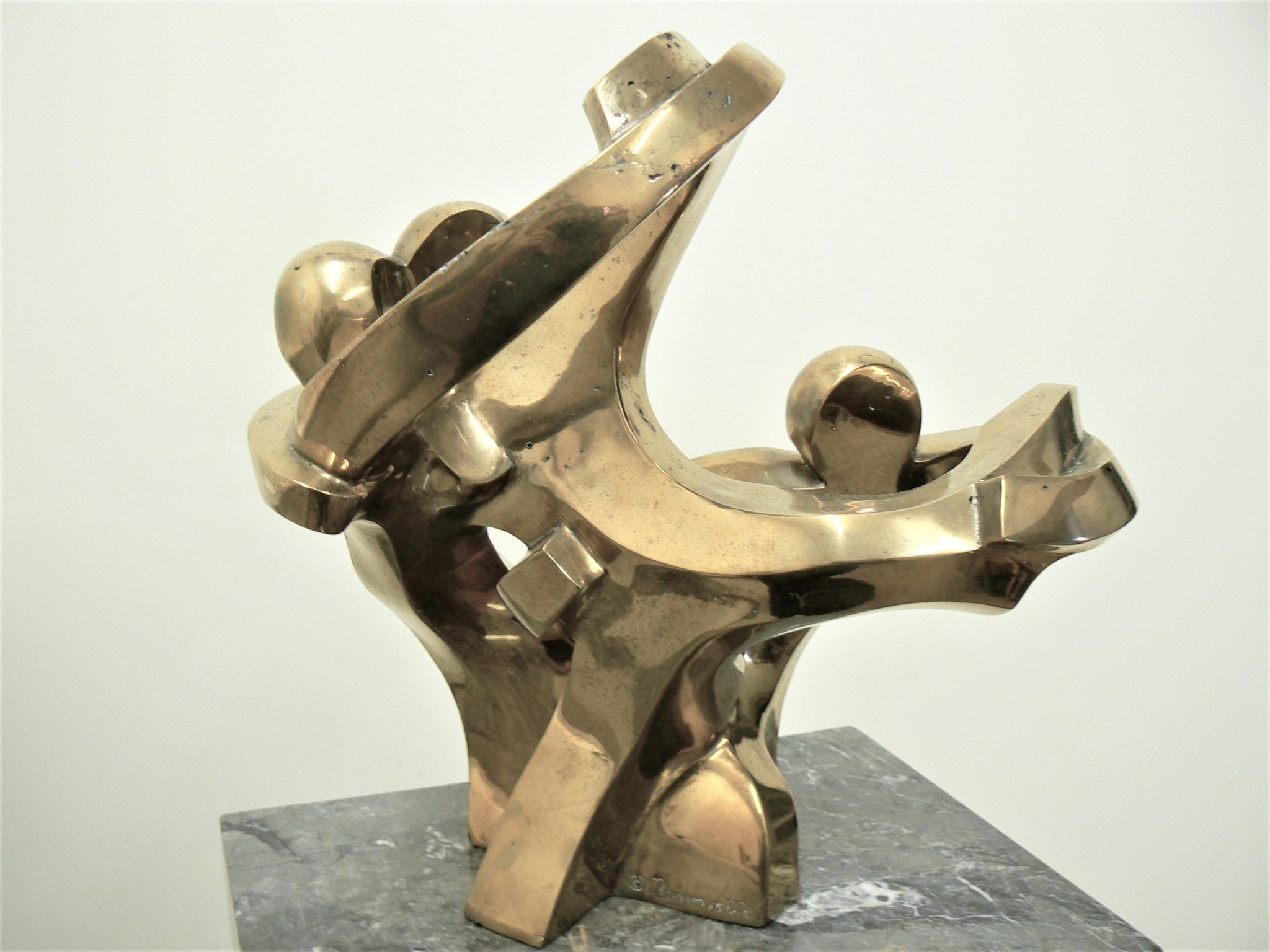 Dancing Trio, polished bronze on black marble